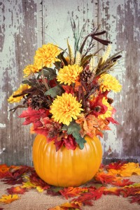 Autumn pumpkin flower arrangement centerpiece rustic background vintage filter effects