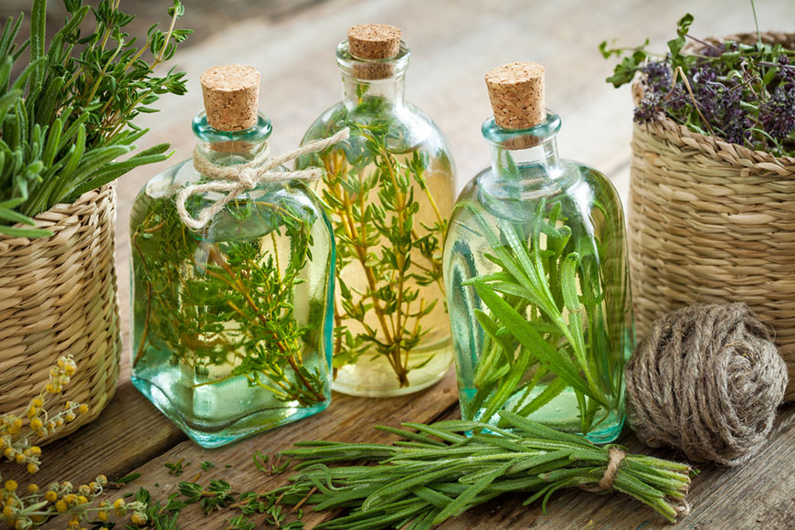 bottles of thyme and rosemary