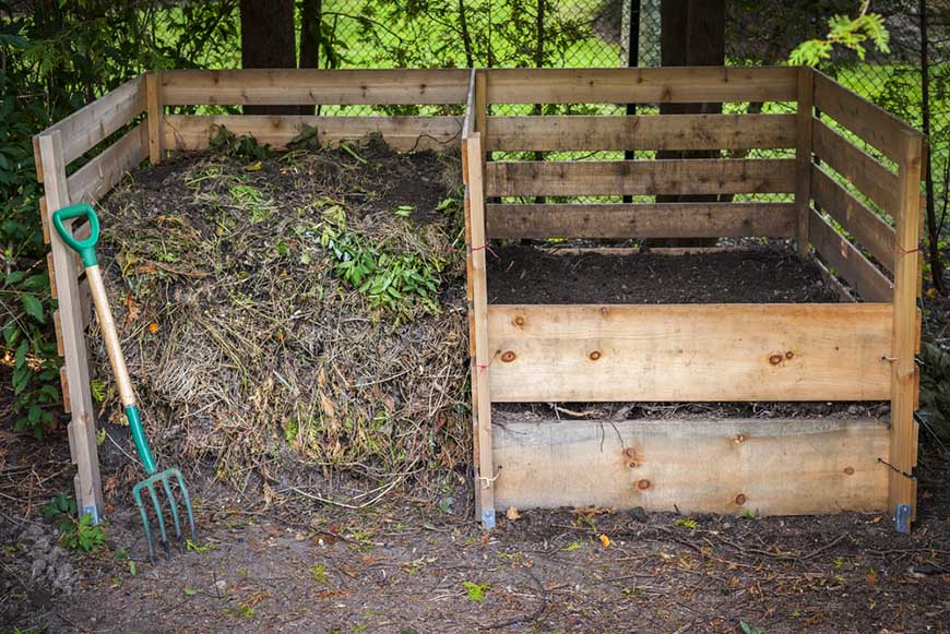large cedar boxes of compost
