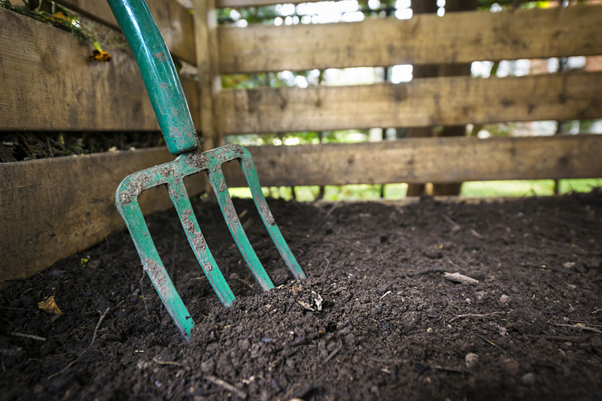 pitch fork in compost soil